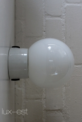 Porcelain purpose lamp with opal glass ball shade in  the style of the Bauhaus era. Those porcelain lamps were designed with a strong  focus on      functionality, manufacturing started around 1920/25. Usually  installed      in all industrial sectors as well as functional areas like   kitchens,     bathrooms, halls, courtyards, cellars and chambers. While production in Western Europe changed to plastic (petroleum) from...